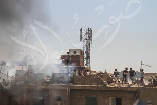 حريق بسوق الملابس في إمبابة (9)
