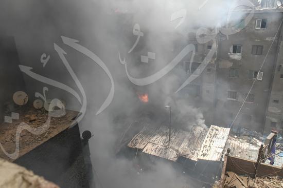 حريق بسوق الملابس في إمبابة (7)