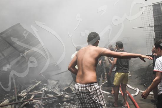 حريق بسوق الملابس في إمبابة (10)