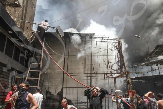 حريق بسوق الملابس في إمبابة (5)