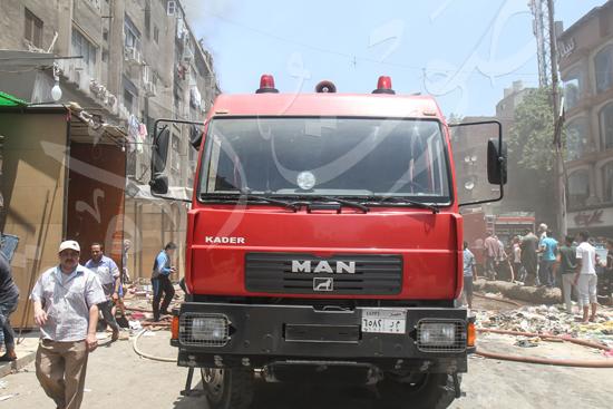 حريق بسوق الملابس في إمبابة (4)