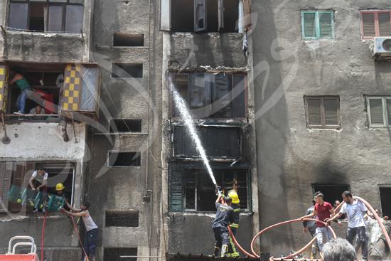 حريق بسوق الملابس في إمبابة (12)