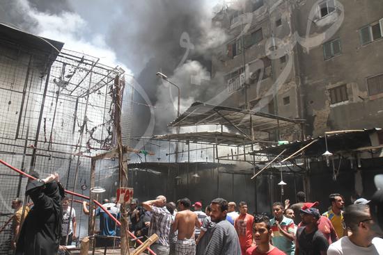 حريق بسوق الملابس في إمبابة (6)