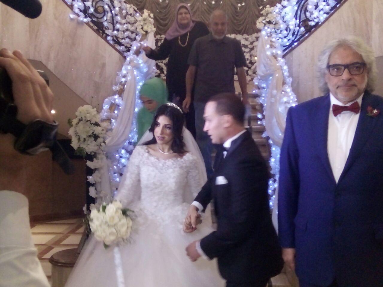 127809-احمد-ناجى-مع-العروسين