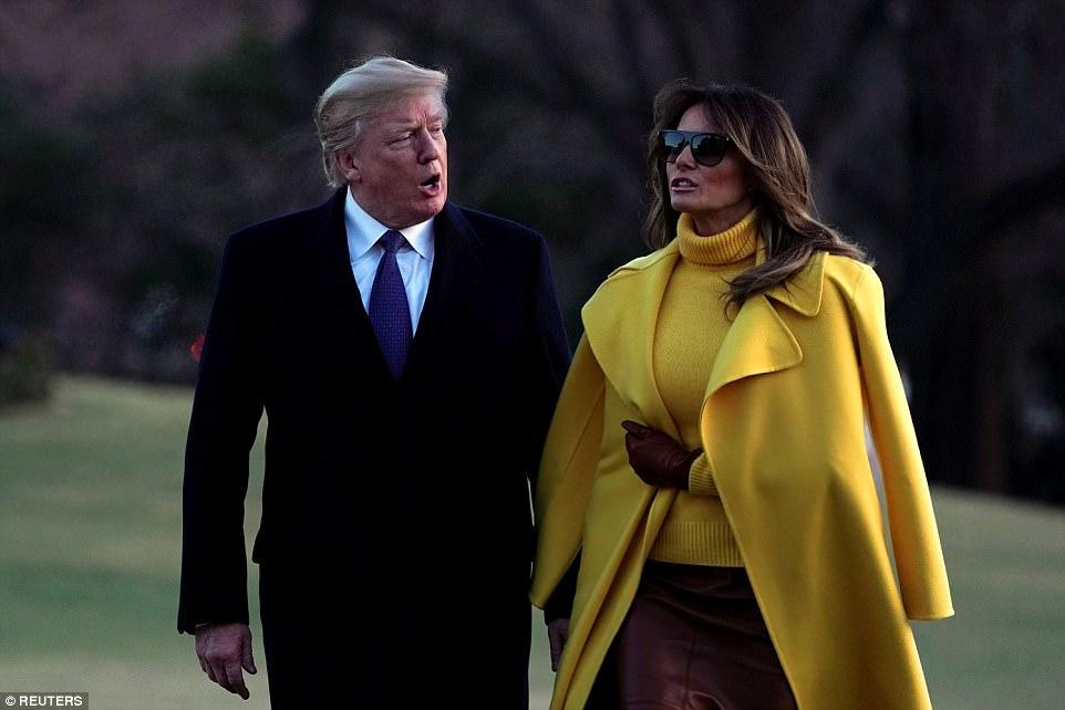 ميلانيا ترامب تنفض يد ترامب أمام العالم (16)