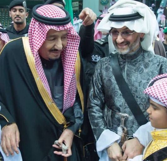 الوليد بن طلال مع الملك لمان