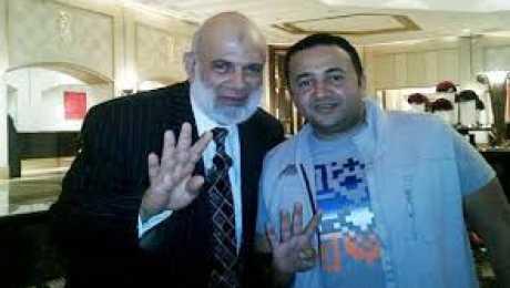 عمرو عبد الهادى مع وجدى غنيم فى قطر