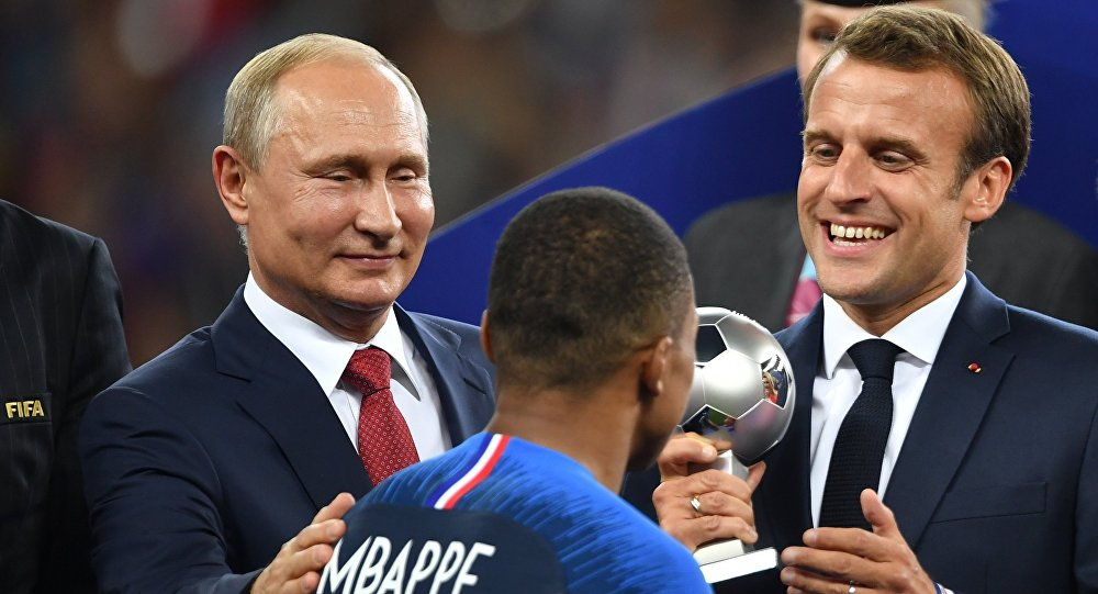 بوتين والرئيس الفرنسي