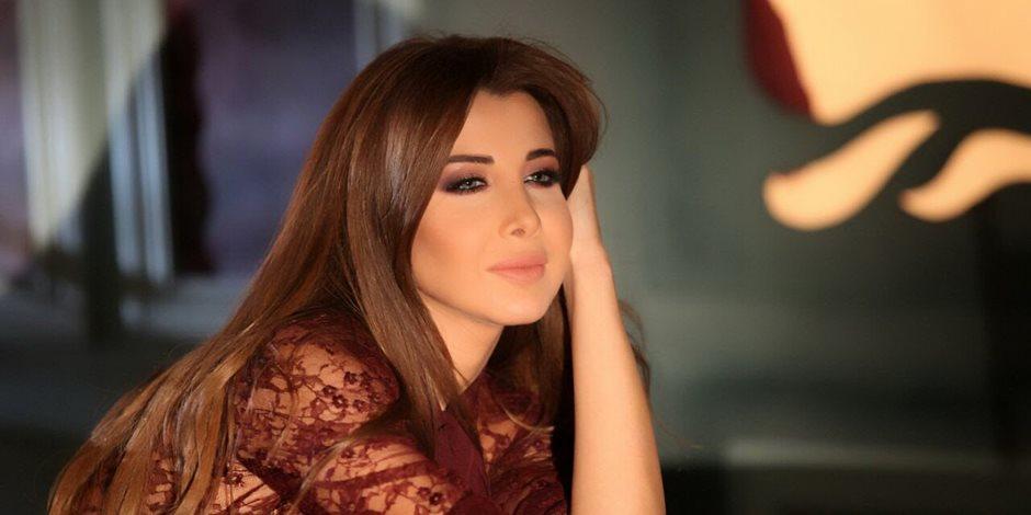 نانسي عجرم تتألق خلال حفلها الغنائى في دبي (صور)