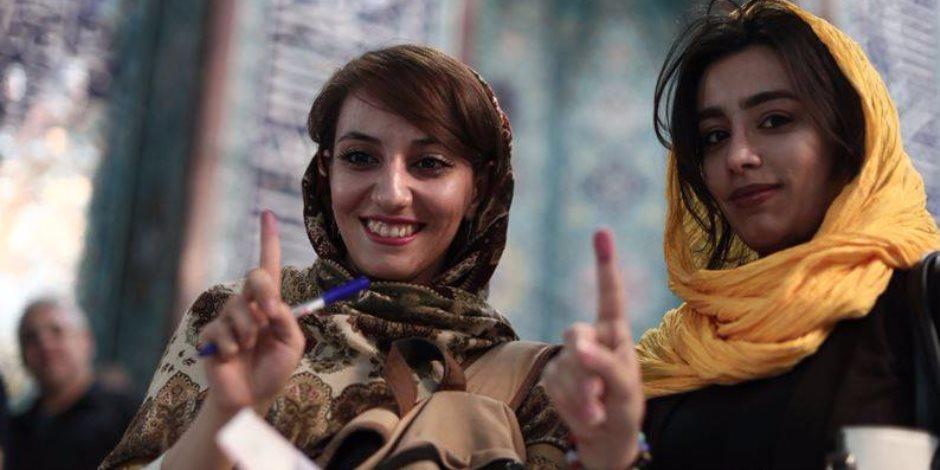 «النُص الحلو» في الانتخابات الإيرانية (صور)