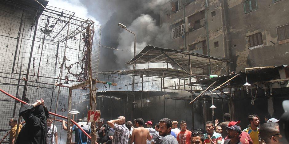 حريق هائل بسوق الملابس في إمبابة(صور)