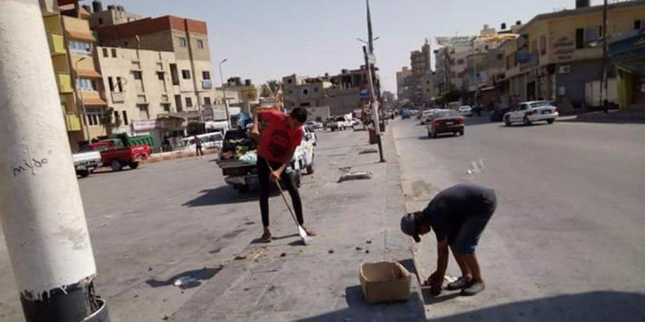 مجلس مدينة العريش» ينهي أزمة تراكم القمامة بالضاحية والساحل (صور)