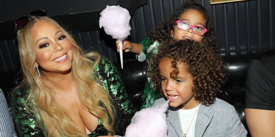 """ماما """"ماريا كاري"""" تقبل توأمها في حفل رأس السنة (فيديو)"""
