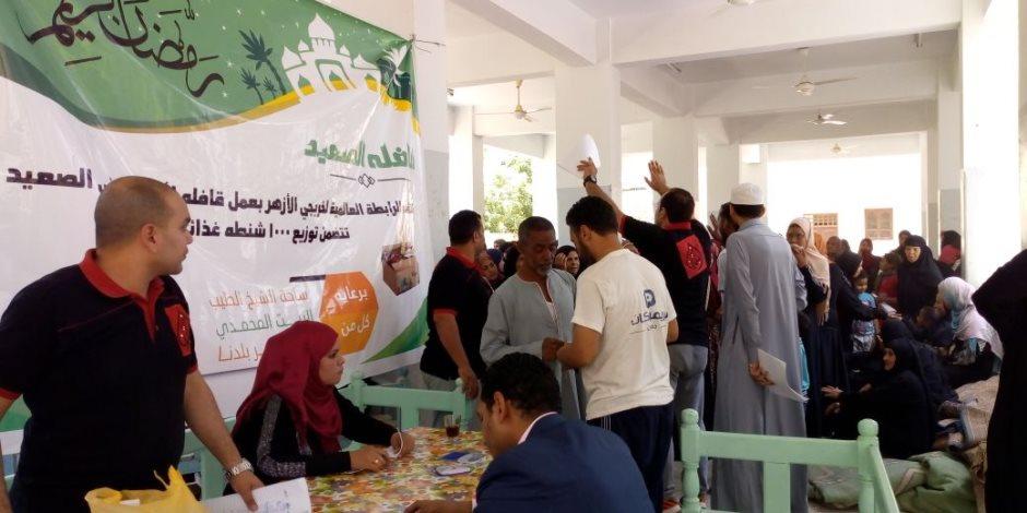 «خريجي الأزهر» توزع 1000 كرتونة رمضانية على الأسر الأكثر احتياجا بالأقصر (صور)
