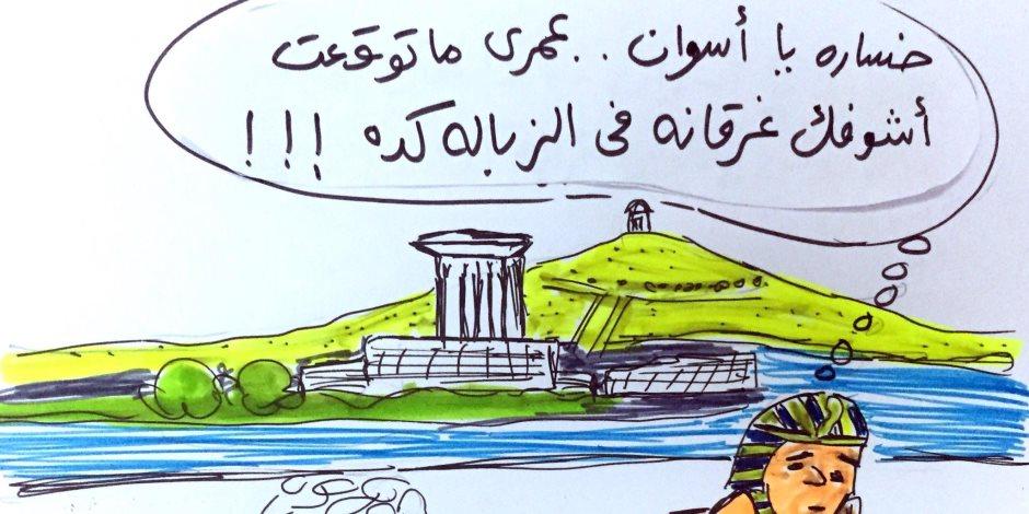 «كاريكاتير فرعوني ساخر» لمرشد سياحي يرصد به مشكلة انتشار القمامة في أسوان