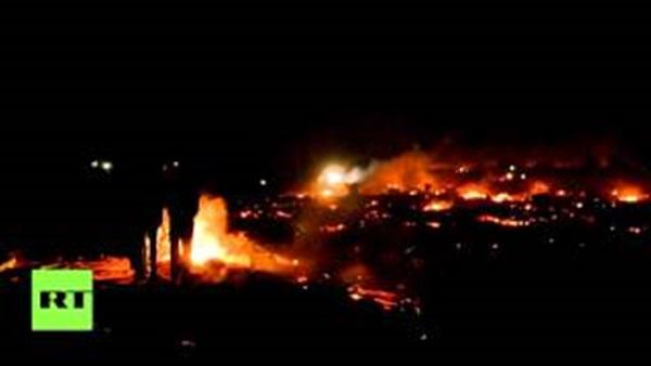 بالفيديو.. إندلاع النيران في مخيم إثر الهجوم الإرهابي بباريس