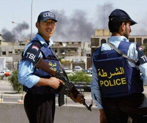 الشرطة الاتحادية العراقية ترفع العلم العراقي فوق حي الزنجلي غرب الموصل