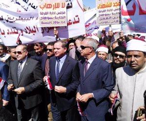 """محافظ سوهاج ومدير الأمن يقودان مسيرة """"استنكارا للإرهاب وتأييدا ودعما للشرطة """" (صور)"""