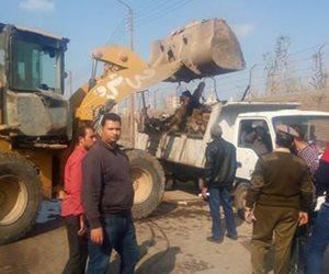 شرطة المرافق تزيل الإشغالات والتعديات بميادين وشوارع الجيزة