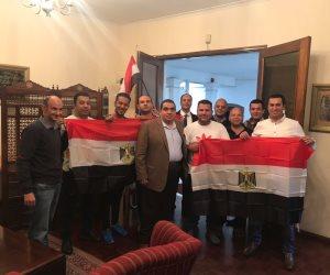 """المصريون في جنوب أفريقيا: تحت المطر غنينا """"تحيا مصر"""""""