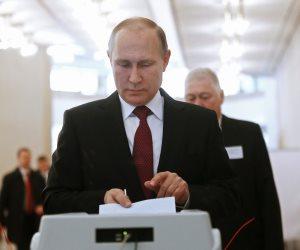 10 مشاهد تلخص الانتخابات الرئاسية الروسية (صور)