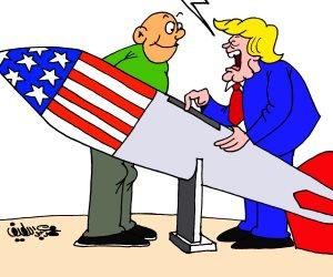 العدوان على سوريا باستخدام الصواريخ: «ذكية يعني بتضرب بالفيزا كارد» (كاريكاتير)