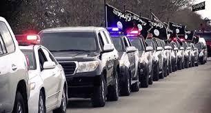 سيارات رفعت علم داعش في ليبيا