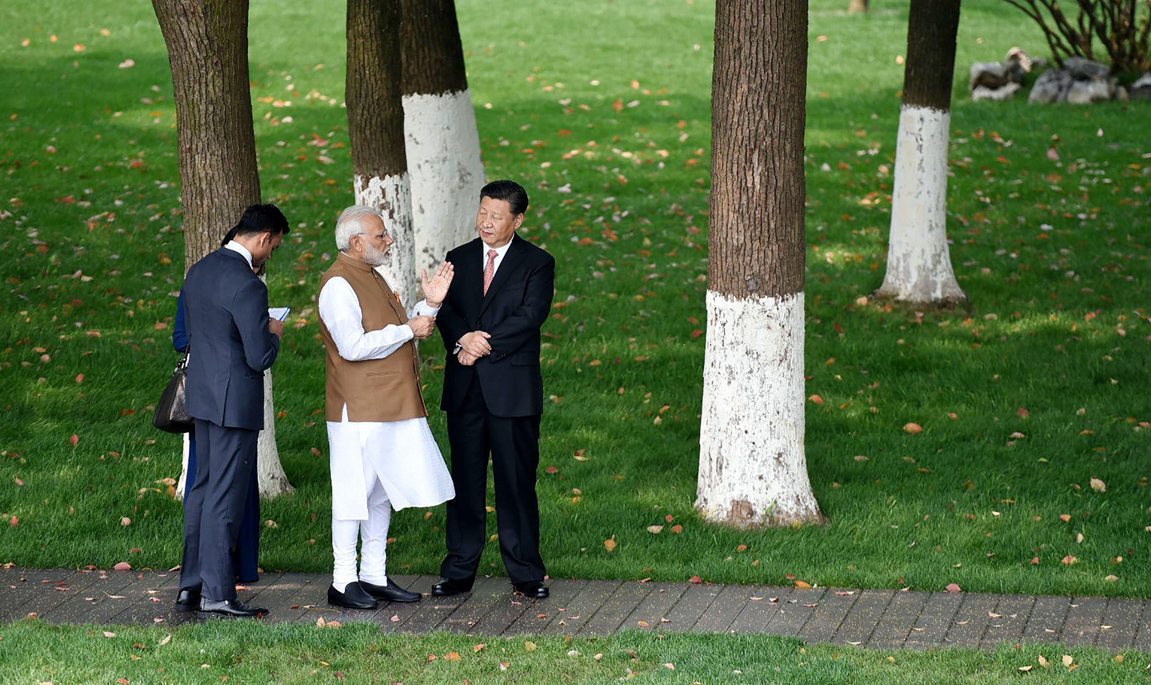صور لقاء الرئيس الصينى ورئيس وزراء الهند (4)