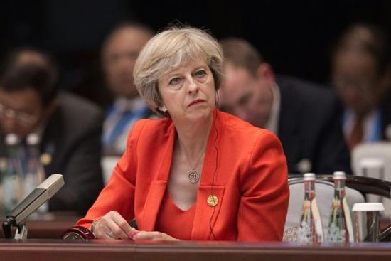 رئيسة الحكومة البريطانية تيريزا ماي copy