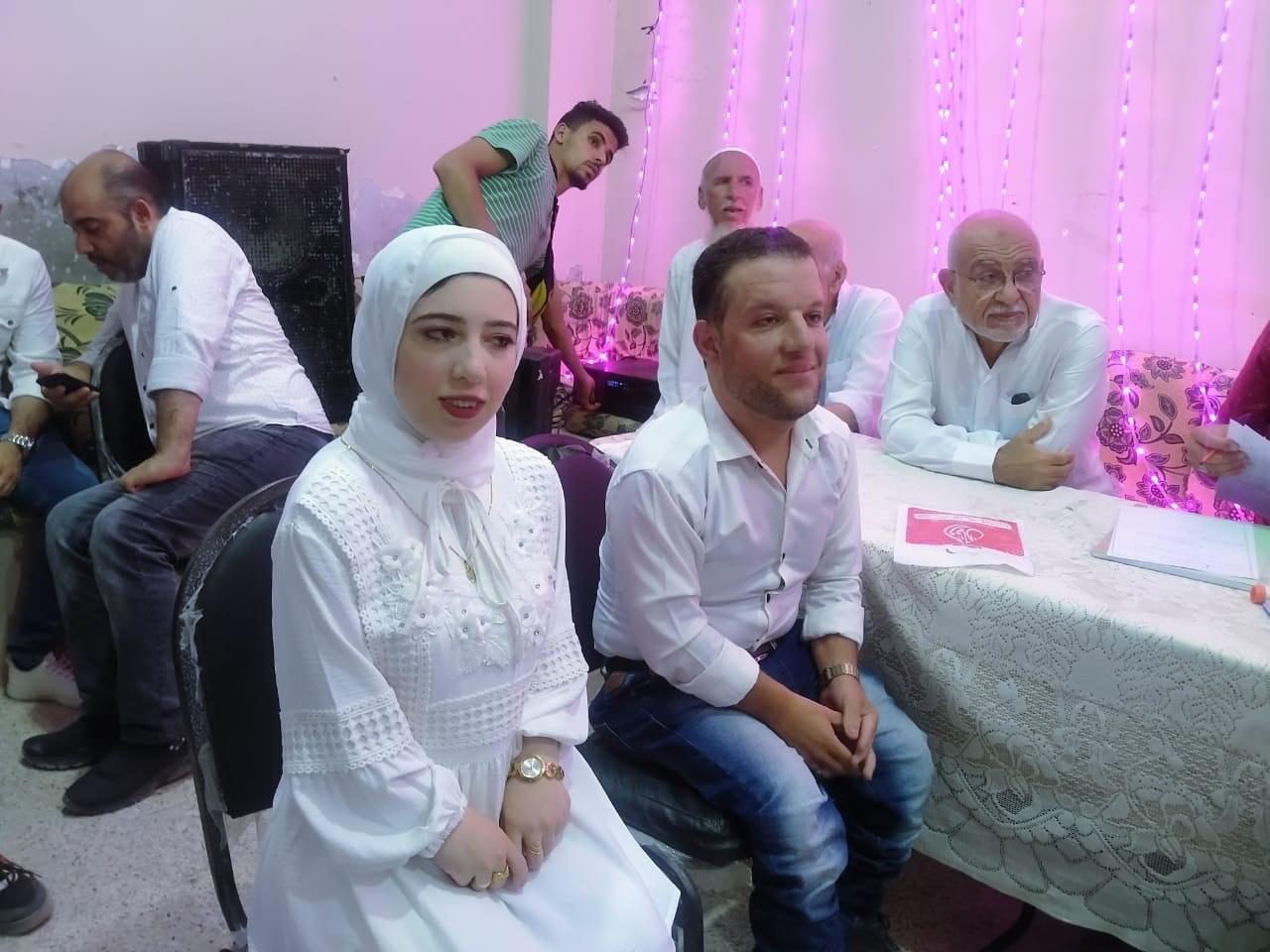 عقد قران العروسين اسماء وحسين