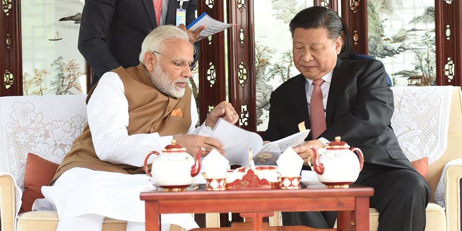 الرئيس الصيني ورئيس الوزراء الهندي يتفقان على خفض التوتر الحدودي بين البلدين(صور )
