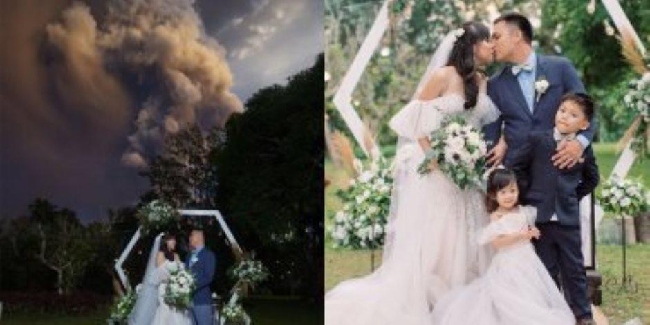 زواج على حافة الخطر.. عروسان يلتقطان صور زفافهما أمام بركان ثائر