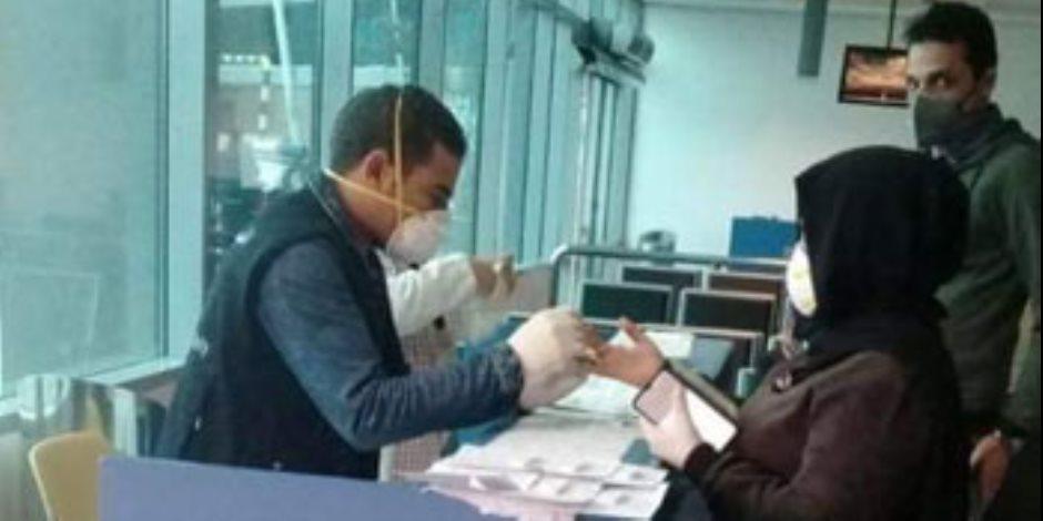مطار القاهرة يستقبل رحلة استثنائية قادمة من عمان تقل 135 مصريا.. صور