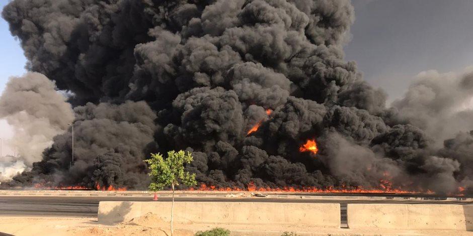 """حريق مخزن مواد بترولية بطريق """"السويس - القاهرة"""" وعربات الإطفاء تحاول إخماده"""