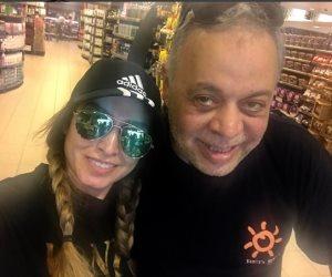 أشرف زكي وروجينا أثناء التسوق على «إنستجرام»