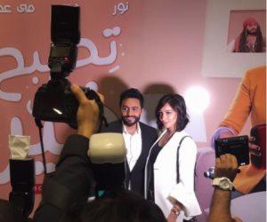 كيدهن عظيم.. هل تثير معجبات تامر حسني أزمة مع زوجته بسمة بوسيل؟