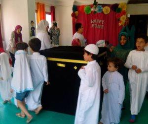 أطفال يؤدون فريضة الحج والاحتفال بوقفة العيد وذبح أضحية العيد.. (صور وفيديو)