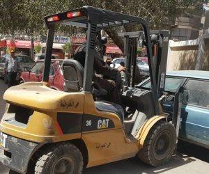 رفع السيارات المتهالكة والإشغالات بمحيط لجان الانتخابات بالعمرانية (صور)