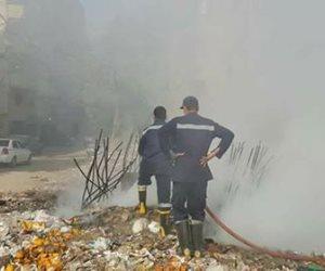 الحماية المدنية تسيطر على حريق في ترعة الزمر بالجيزة (صور)