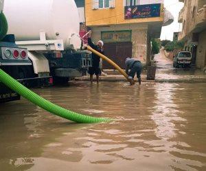 الدفع بسيارات كسح لسحب مياه الأمطار  من شوارع بئر العبد بشمال سيناء (صور)