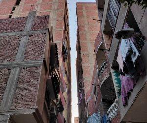 رجل أعمال طماع ومقاول فاسد.. عقار مائل في الهرم ارتفاعه 14 طابقا يهدد بكارثة